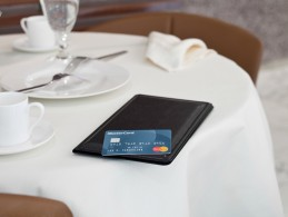 MasterCard Standard Credit Card and check presenter on table in restaurant