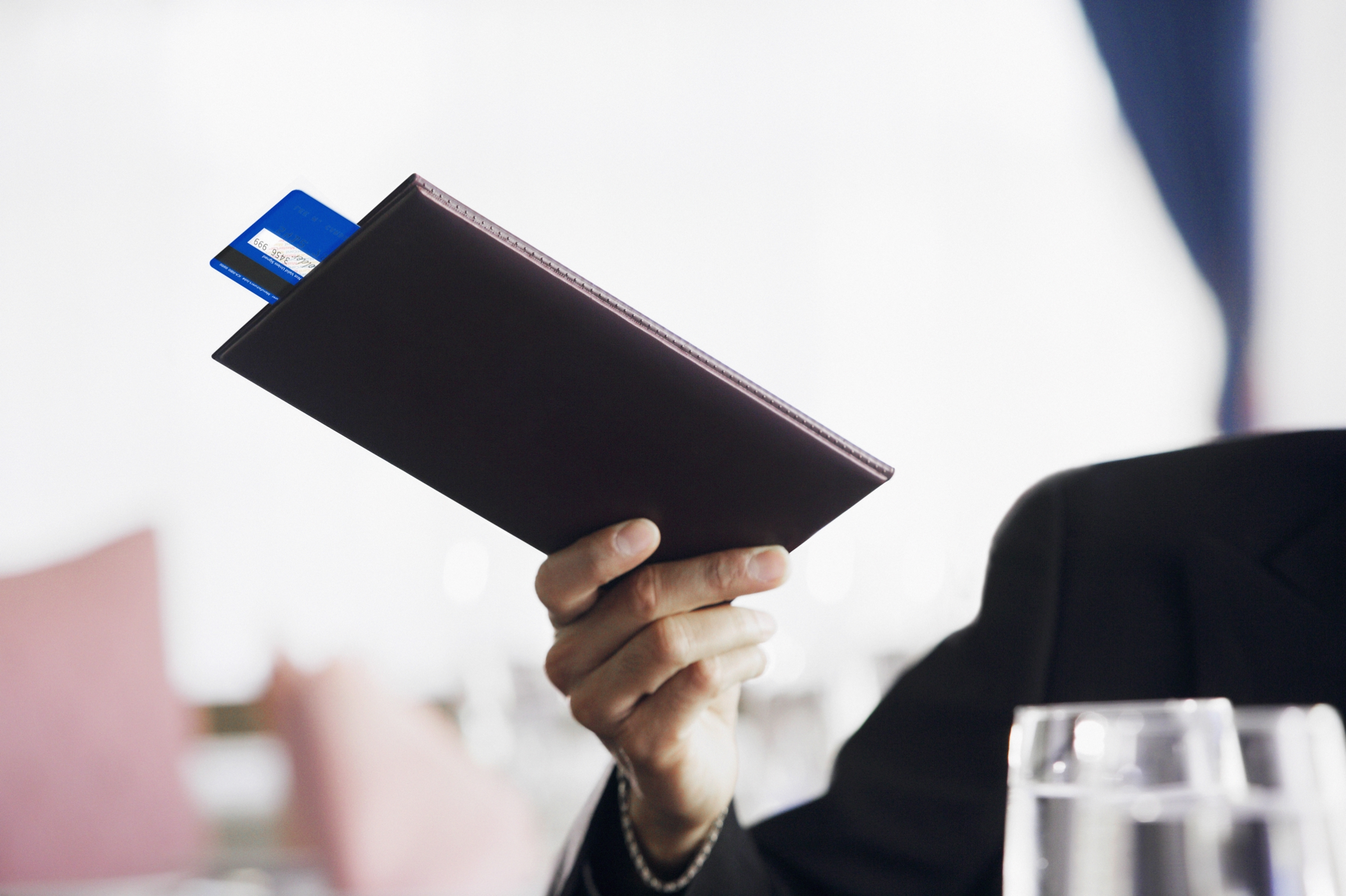 Businessman paying the check at restaurant