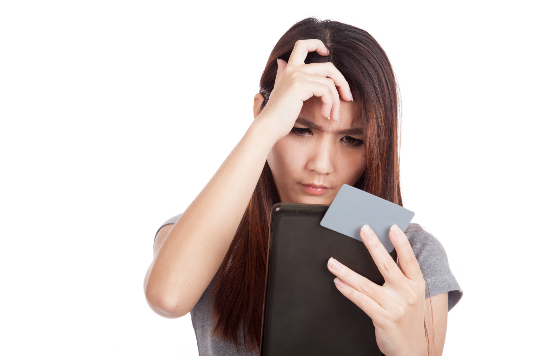 Serious Asian woman with blank card and tablet PC