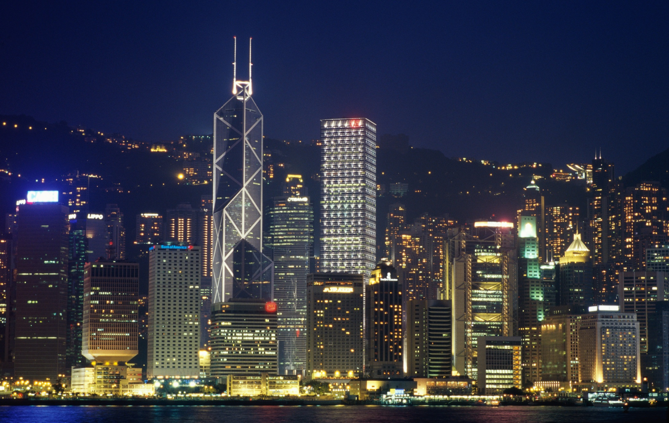 High angle view of a city lit up at night, Hong Kong, China