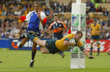 ADELAIDE, AUSTRALIA - OCTOBER 25: Stirling Mortlock of the Wallabies crosses for a try during the Rugby World Cup Pool A match between Australia and Namibia at Adelaide Oval October 25, 2003 in Adelaide, Australia. (Photo by Nick Laham/Getty Images)