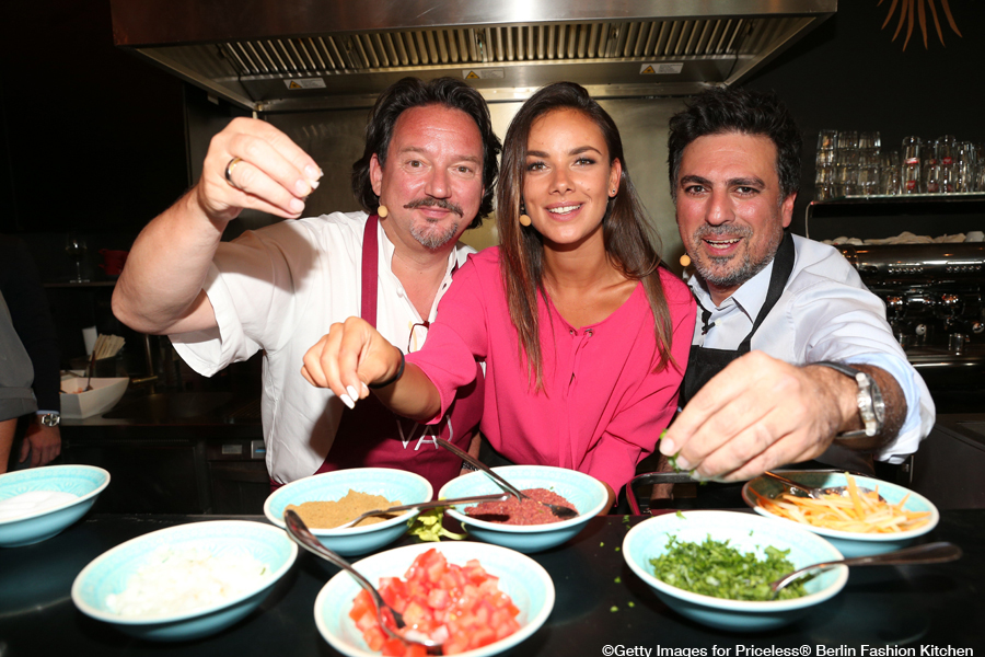 BERLIN, GERMANY - JUNE 29: Kolja Kleeberg and Janina Uhse and Shan Rahimkhan cook during the Mastercard Priceless Fashion Kitchen Party at Shan Rahimkhan's Bistro during the Mercedes-Benz fashion week on June 29, 2016 in Berlin, Germany. (Photo by Gisela Schober/Getty Images for Mastercard Priceless)