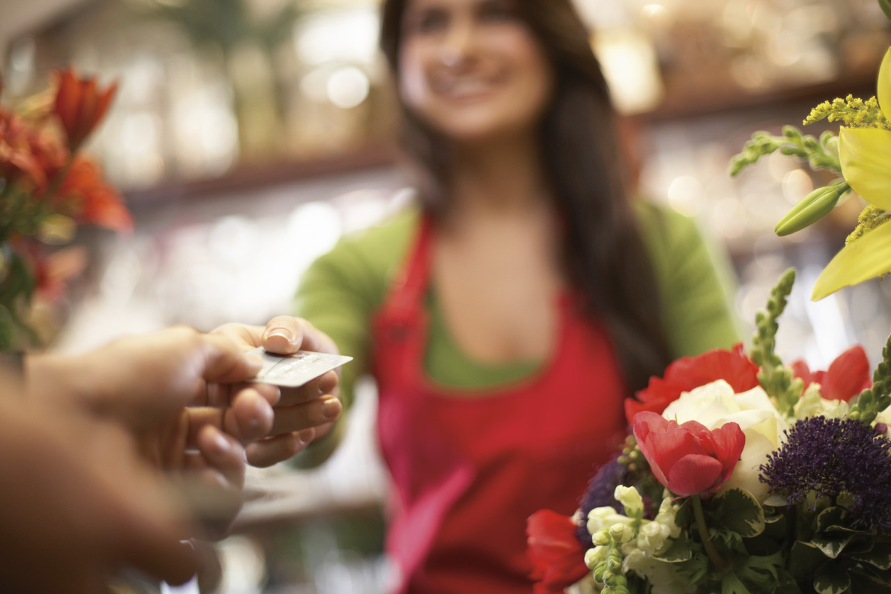 Man Buying Flowers --- Image by © Royalty-Free/Corbis