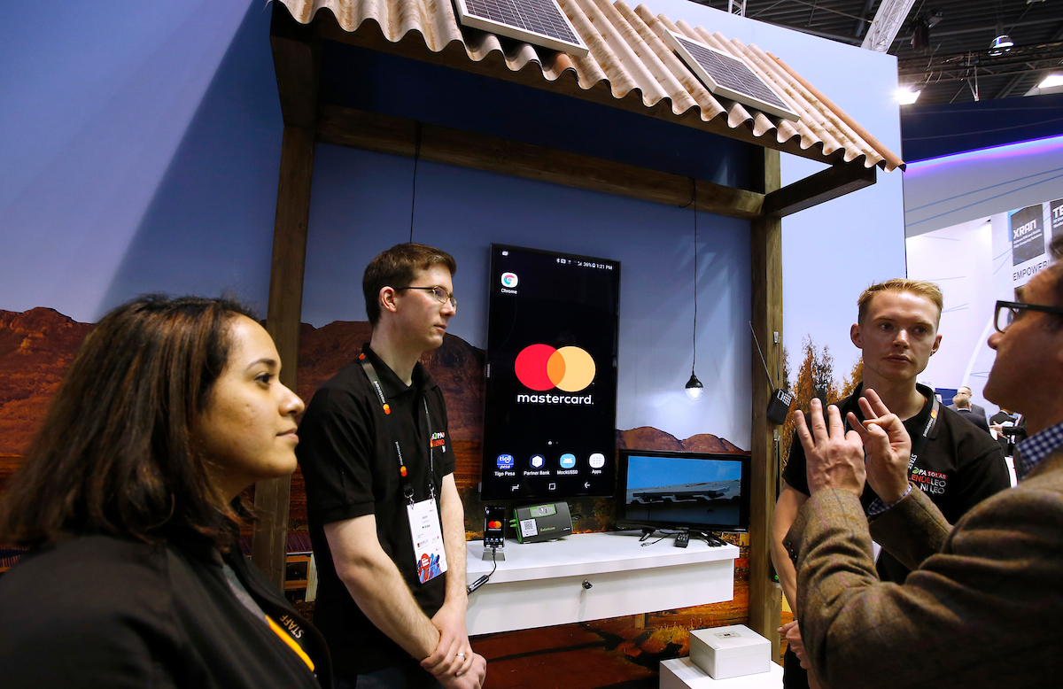 IMAGE DISTRIBUTED FOR MASTERCARD - IoT in action as Mastercard and M-KOPA announce partnership to light up homes and payments at the 2018 Mobile World Congress on Monday, Feb. 26, 2018 in Barcelona, Spain. (Manu Fernandez/AP Images for Mastercard)