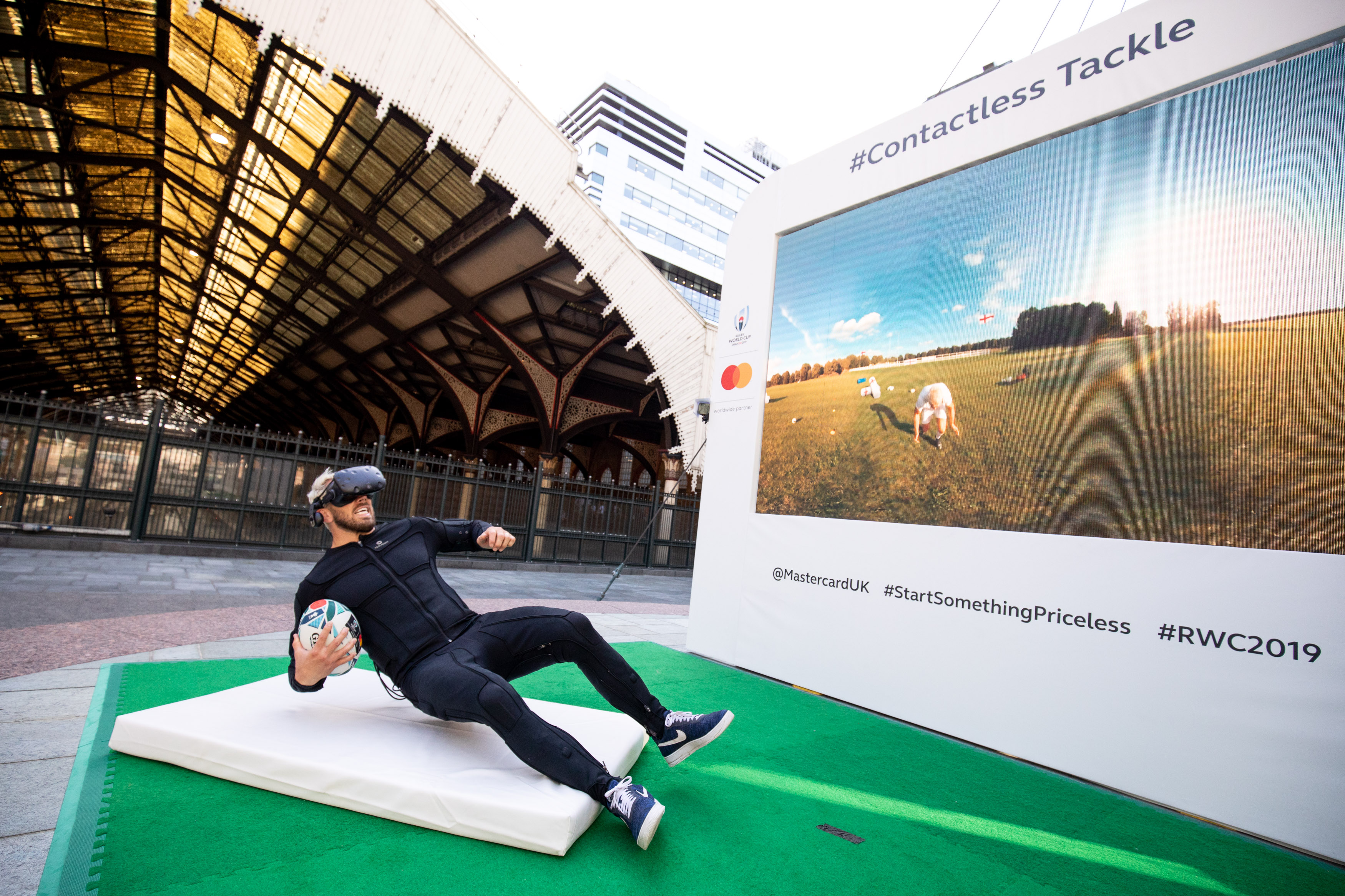 Chris Robshaw experiences the full force of being tackled by himself in Mastercard's Contactless Tackle