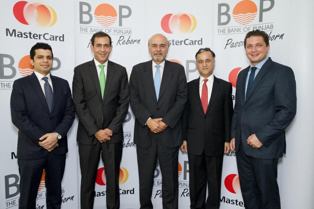 Raghu Malhotra, Mohamed Qadadeh and Aurangzaib Khan from MasterCard with Naeemudin Khan and Mustafa Hamdani from Bank of Punjab