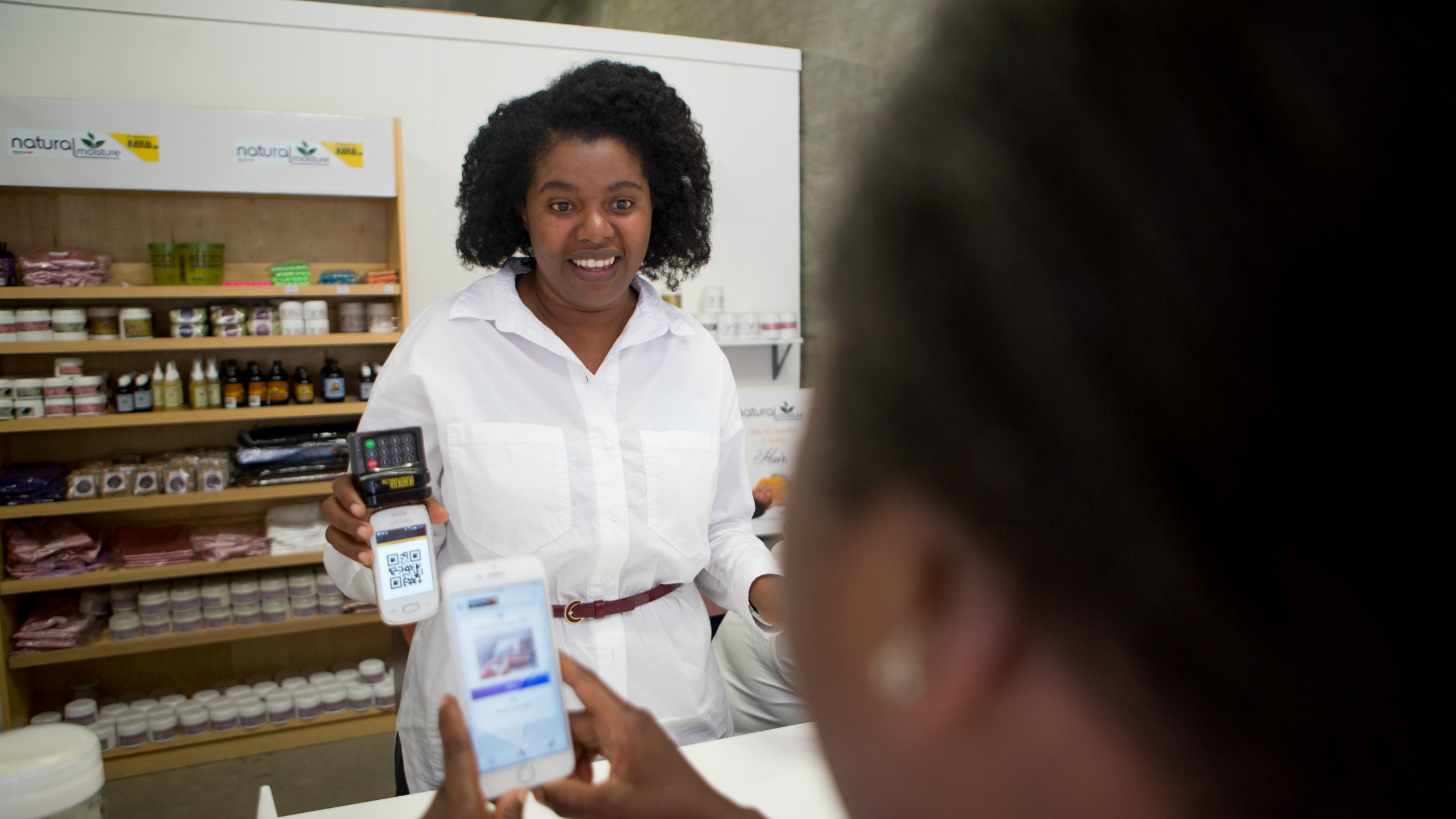 Small business owners like Ruth Mafupa, owner of Natural Moisture in Johanneburg, can now accept card payments on the iKhokha device connected to their smartphones, as well as online and in-store digital MasterPass payments.