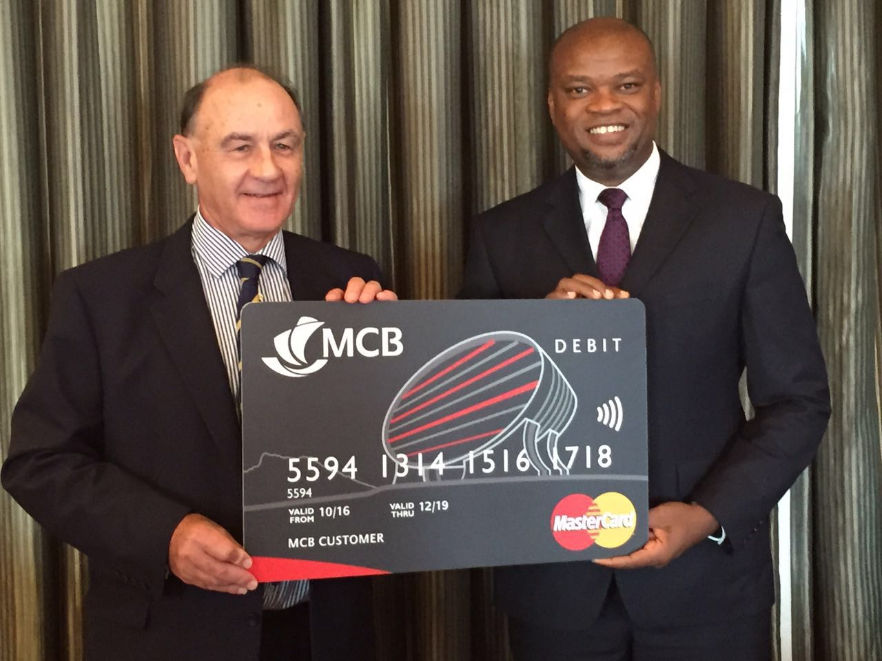 MCB Group Chief Executive Antony Withers with Daniel Monehin, Division President for Sub Saharan Africa at Mastercard announce launch of contactless payment solution in Mauritius.