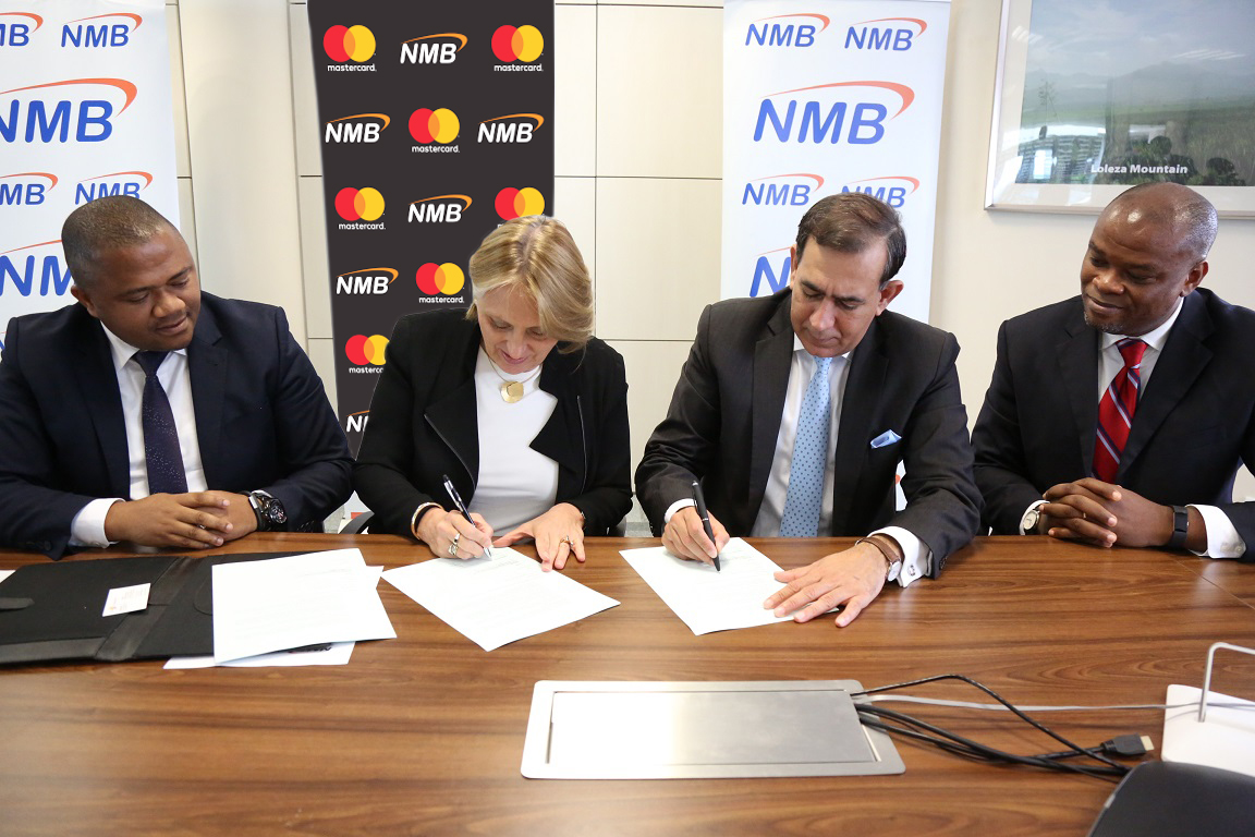 1.NMB Managing Director – Ineke Bussemaker signing a partnership agreement with Mastercard President for Middle East and Africa – Raghu Malhotra at a press signing ceremony held in Dar es Salaam today. The partnership will pave way for digitization of the agricultural sector in Tanzania with the rollout of eKilimo, a mobile solution developed by the Mastercard Lab for Financial Inclusion. Looking on the left is the NMB Acting Chief Retail Banking – Abdulmajid Nsekela and right is the Mastercard Division President Sub-Saharan Africa – Daniel Monehin.