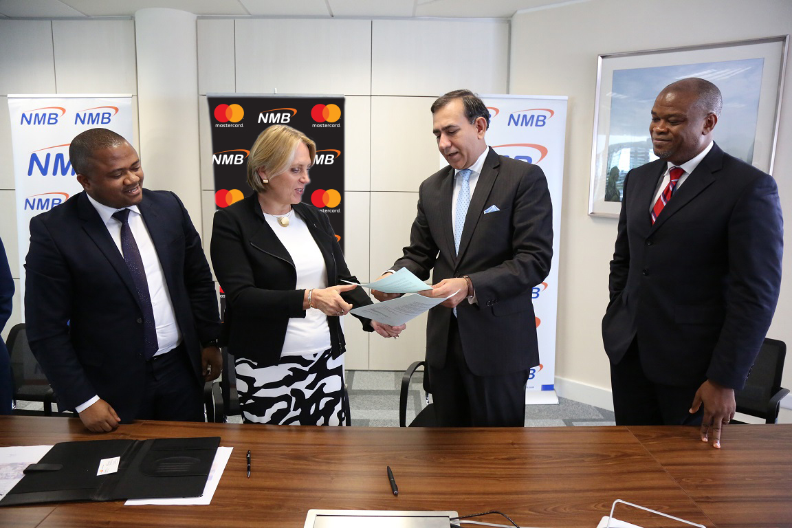 2.NMB Managing Director – Ineke Bussemaker exchanging partnership contracts with Mastercard President for Middle East and Africa – Raghu Malhotra at a press signing ceremony held in Dar es Salaam today. The partnership will pave way for digitization of the agricultural sector in Tanzania with the rollout of eKilimo, a mobile solution developed by the MasterCard Lab for Financial Inclusion. Looking on the left is the NMB Acting Chief Retail Banking – Abdulmajid Nsekela and right is the Mastercard Division President Sub-Saharan Africa – Daniel Monehin.