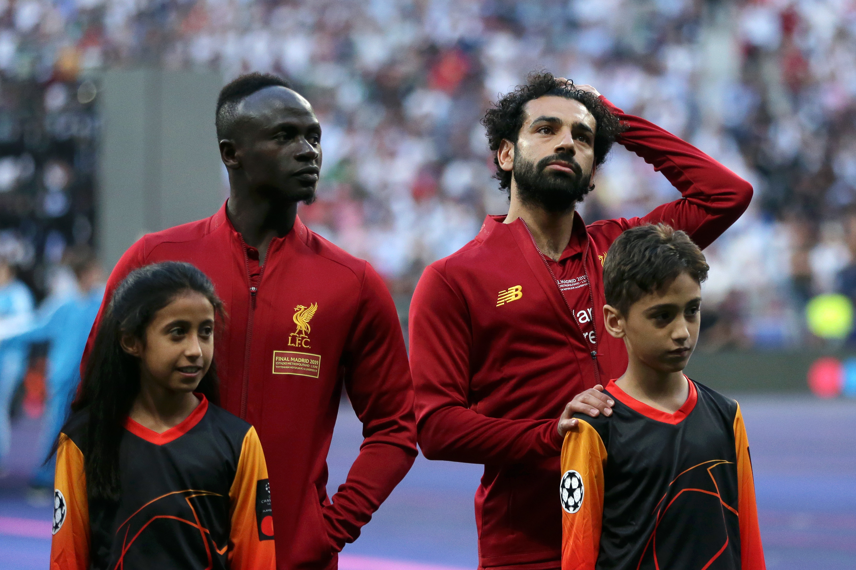 MADRID, SPAIN - JUNE 01:  Sadio Mane and Mohamed Salah of Liverpool look on prior to the UEFA Champions League Final between Tottenham Hotspur and Liverpool at Estadio Wanda Metropolitano on June 01, 2019 in Madrid, Spain. (Photo by Gonzalo Arroyo - UEFA/UEFA via Getty Images)