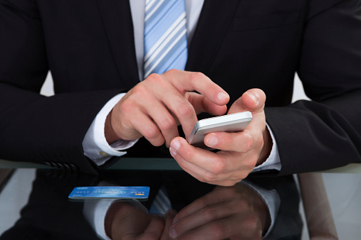 Businessman sending a text message or sms