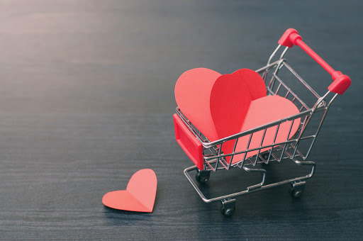 Valentines concept, Full of hearts in the shopping cart on wooden floor.