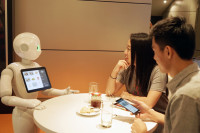 Flickr Photo: Pepper takes orders from customers at the MasterCard Cafe