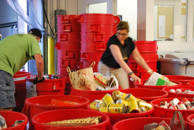 Volunteer loading food for the St. Louis Area Foodbank
