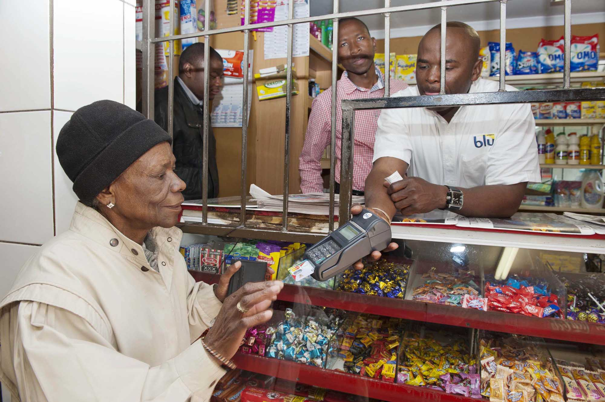 South African woman with SASSA MasterCard