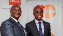 Mastercard Regional Vice President James Wainana (left) hands over the Certificate to GT Bank Kenya MD Adekunie Sonola