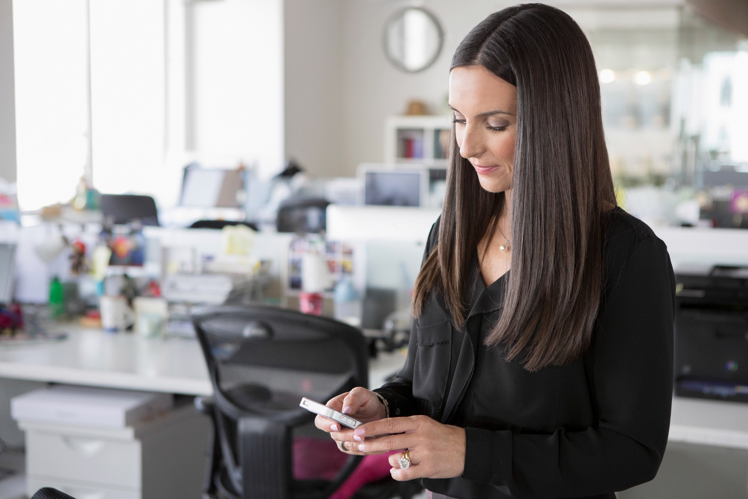 Businesswoman texting in office