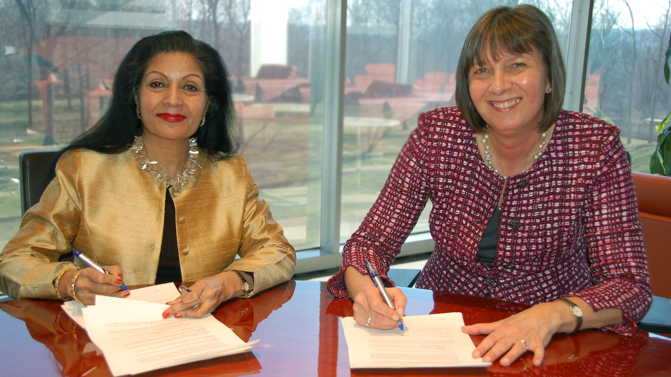In Purchase NY, MasterCard's CFO, Martina Hund-Mejean signs a Memorandum of Understanding (MOU), with Lakshmi Puri, United Nations Assistant Secretary-General Deputy Executive Director.