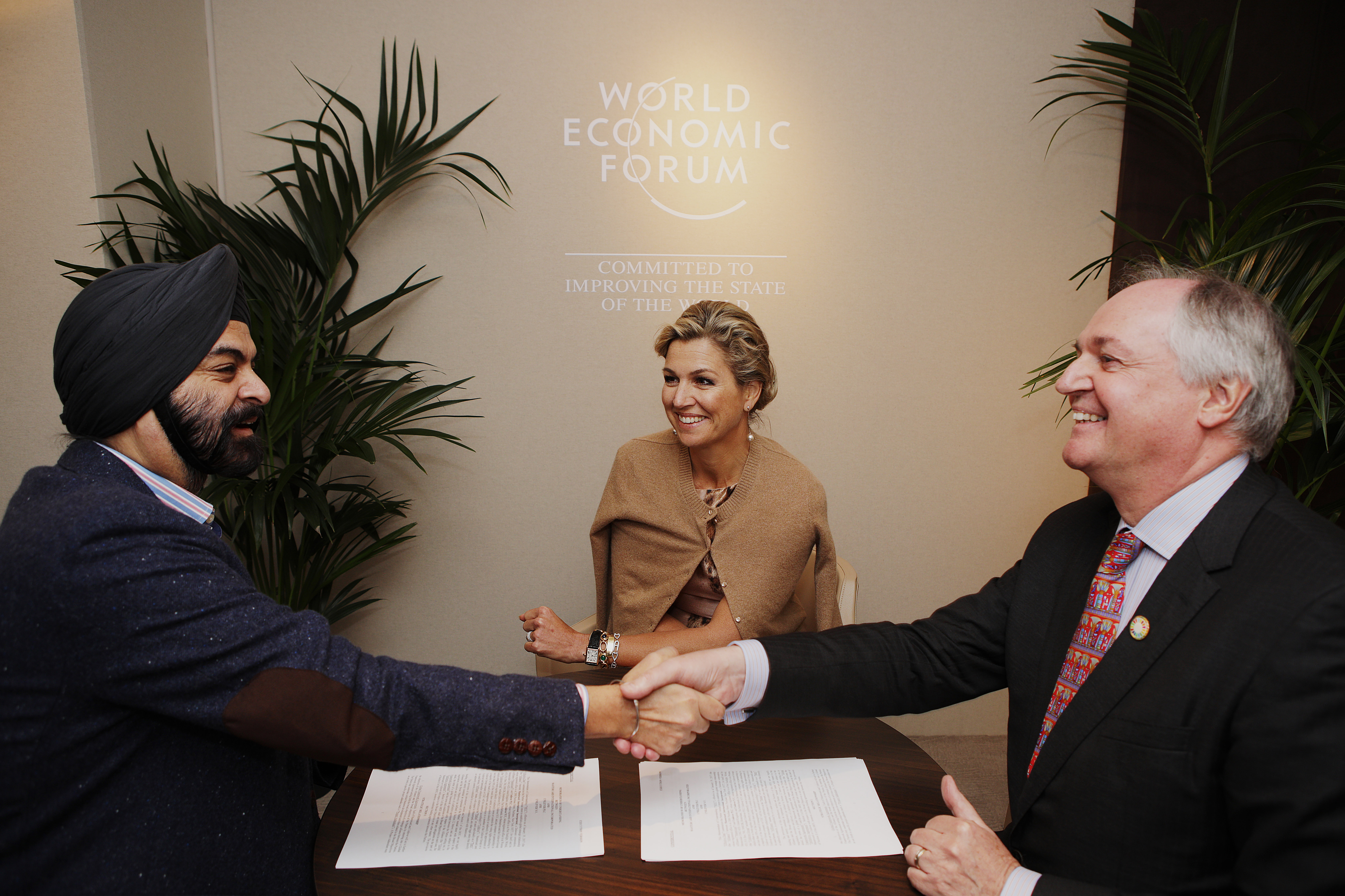 During the World Economic Forum's Annual Meeting in Davos, Her Majesty Queen Maxima of the Netherlands, UN Secretary-General's Special Advocate for Inclusive Finance for Development (center) witnessed Ajay Banga, president and CEO of Mastercard (left), and Paul Polman, Chief Executive of Unilever (right), signing a strategic partnership designed to advance financial inclusion efforts by empowering small and micro businesses in emerging markets.