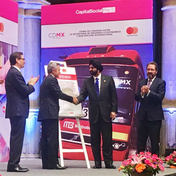Miguel Angel Mancera, Mayor of Mexico City (left), and Ajay Banga, Mastercard CEO, mark a comprehensive agreement