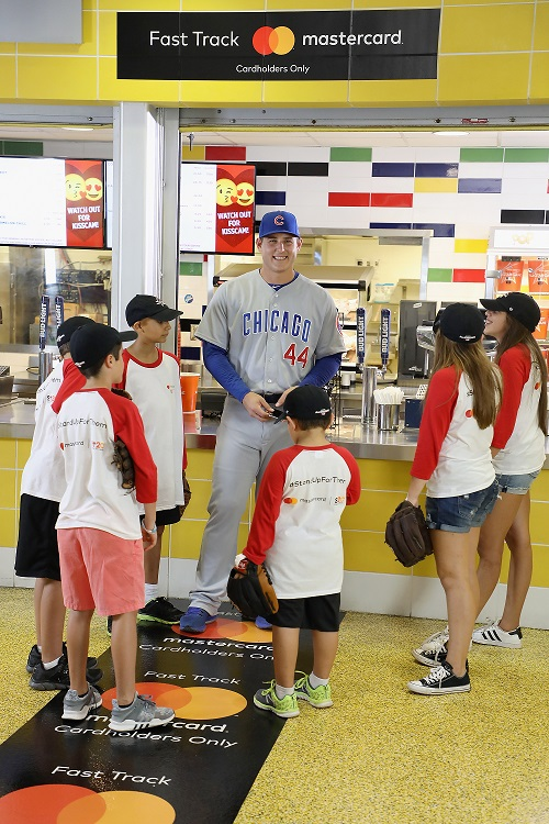•Mastercard ambassador Anthony Rizzo uses his Masterpass at Marlins Park concession to buy lunch for young cancer survivors at Marlins Park in Miami, FL in an effort to generate awareness of the Mastercard partnership with Stand Up To Cancer and the annual dine out campaign. (Photo by Alexander Tamargo/Getty Images for Mastercard)