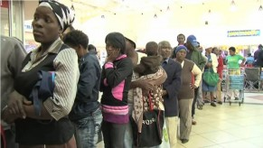 Flickr Photo: A queue of SASSA grant recipients awaiting the collection of their monthly grants