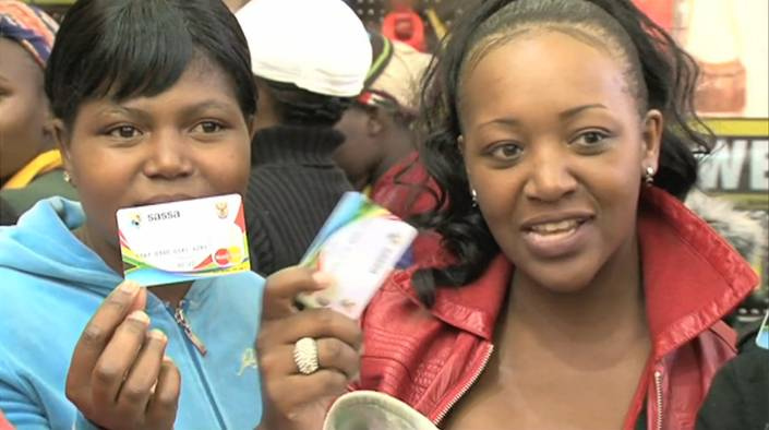 Flickr Photo: Two child grant recipients collecting their grants from a SASSA pay point