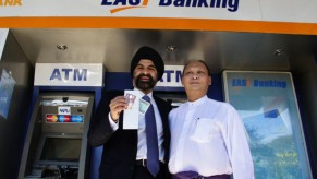 Flickr Photo: Ajay Banga, President and CEO of MasterCard Worldwide with U Kyaw Lynn, Executive Vice Chairman and CEO of CB Bank with local Myanmar kyats withdrawn from a CB Bank ATM