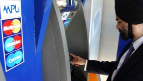 Flickr Photo: Ajay Banga, President and CEO of MasterCard Worldwide withdraws cash in local Kyats from a CB Bank ATM in Yangon, Myanmar
