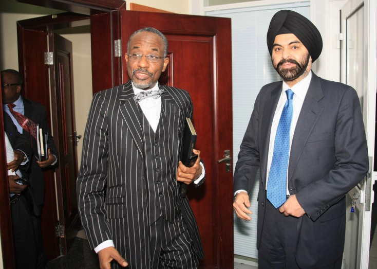 Ajay Banga, MasterCard Worldwide President and CEO, right, and Sanusi Lamido Sanusi, Governor of the Central Bank of Nigeria, discuss the milestones achieved by Nigeria's cashless initiative in Abuja, Nigeria, on Monday Jan. 14, 2013. Banga said the Central Bank of Nigeria's Cashless Policy, and the solutions created to achieve its goals, is viewed with global interest as a benchmark in driving financial inclusion in emerging markets. Driven by local government, the modernization of the Nigerian payments industry will positively impact economic growth in Nigeria by helping to eliminate inefficiency, corruption and fraud, which are issues faced by all cash-dependent economies.