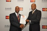 Patrick Akinwuntan, Ecobank Group Executive Director, Domestic Banking receives a congratulatory certificate from Daniel Monehin, MasterCard Division President, SSA to mark the licensing of 28 African Ecobank subsidiaries by MasterCard. The partnership is expected to accelerate the adoption of electronic payments across Africa