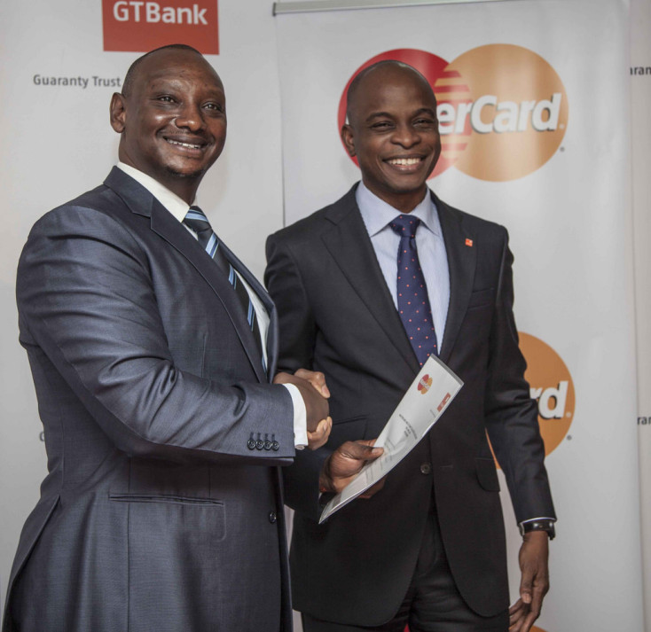 Flickr Photo: MasterCard Area Business Head James Wainaina and GT Bank MD East Africa Adekunle Sonola at the licensing announcement press briefing in Nairobi
